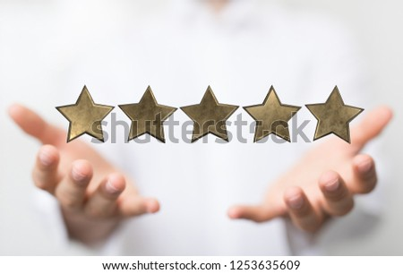 rating with star in hand #1253635609