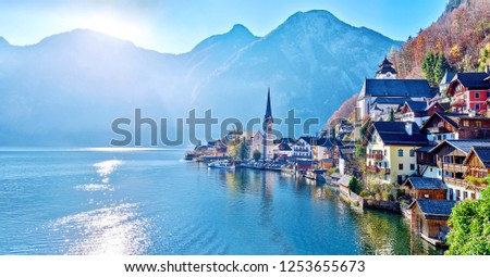 Beautiful late autumn landscape of Hallstatt mountain village with Hallstatter lake in Austrian Alps. Wide Panorama