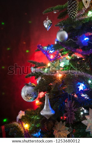 decorated christmas tree with lights on red background #1253680012