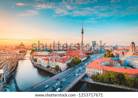 Classic view of Berlin skyline with famous TV tower and Spree in beautiful golden evening light at sunset, central Berlin Mitte, Germany #1253717671