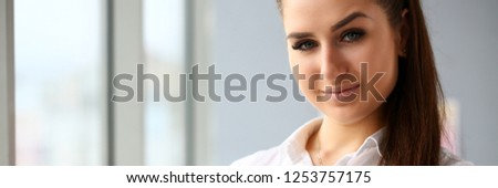 Beautiful smiling girl at workplace look in camera portrait. White collar dress code worker at workspace job offer modern office lifestyle client visit study profession boss market idea coach train #1253757175