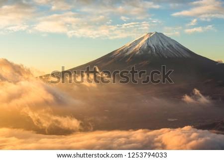 Mount Fuji and fog at sunrise at lake kawaguchi in autumn,Yamanashi,Japan.Fujisan located on Honshu Island, is the highest mountain in Japan. #1253794033