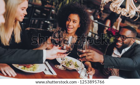 Group Happy Friends Enjoying Dating in Restaurant. Double Couple Dating in Restaurant. Romantic Couple in Love Dating. Friends in a Restaurant Making Order. Romantic Concept. Pouring Glasses Wine #1253895766