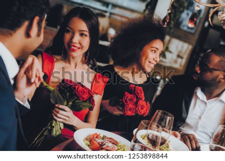 Friends in a Restaurant Enjoying Romantic Evening. Group Happy Friends Enjoying Dating in Restaurant. Double Couple Dating in Restaurant. Romantic Concept. Bouquet Red Roses. Love Concept. #1253898844
