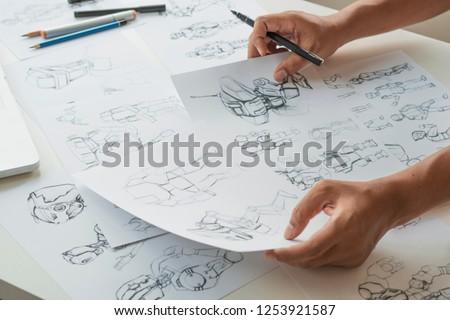 Animator designer Development designing drawing sketching development creating graphic pose characters sci-fi robot Cartoon illustration animation video game film production , animation design studio. #1253921587