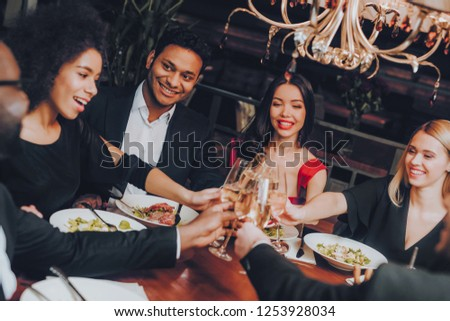 Group of Happy Friends Meeting and Having Dinner. Celebrating with Friends. Party Dinner Table. Enjoying Meal In Restaurant. Restaurant Chilling Out Classy Lifestyle Reserved Concept. #1253928034