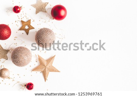 Christmas composition. Christmas red and golden decorations on white background. Flat lay, top view, copy space #1253969761