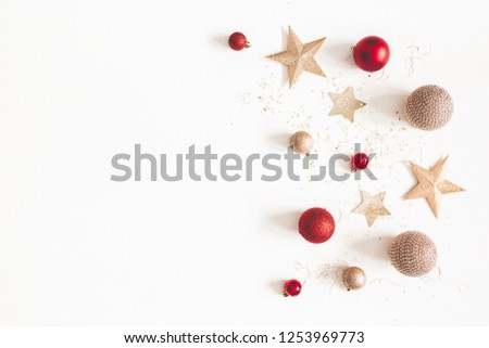 Christmas composition. Christmas red and golden decorations on white background. Flat lay, top view, copy space #1253969773