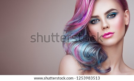 Beauty Fashion Model Girl with Colorful Dyed Hair. Girl with perfect Makeup and Hairstyle. Model with perfect Healthy Dyed Hair. Rainbow Hairstyles #1253983513