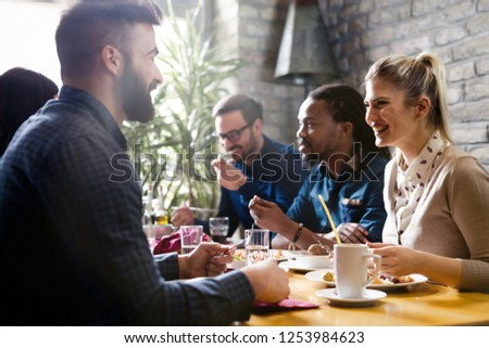 Happy young friends hangout in coffee shop #1253984623
