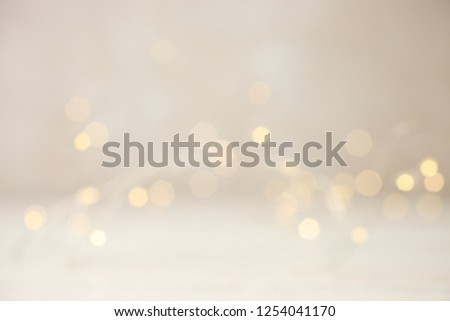 Garland with yellow lights on neutral background. Concept festive background. Copy space.  Royalty-Free Stock Photo #1254041170