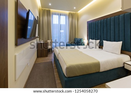 Interior of a hotel bedroom #1254058270
