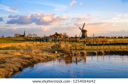 Windmill autumn farm river landscape. Windmill farm scene. Village windmill farm river. Windmill farm river view #1254064642