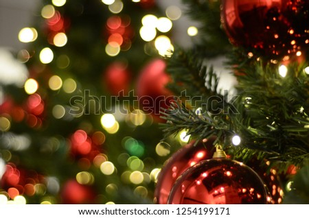 Blurry bokeh sparkling glowing Christmas tree background. Xmas theme #1254199171
