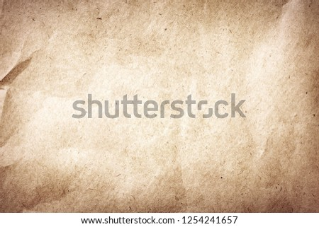 Old brown crumpled and recycled vintage paper texture or background #1254241657