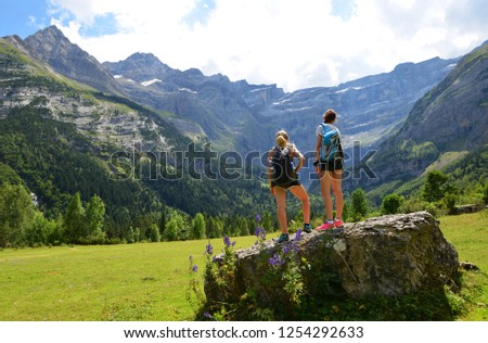 Two tourist in the Pyrenees mountain. Cirque de Gavarnie, France. #1254292633