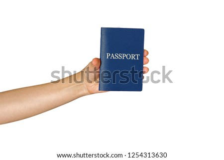 hand holding a passport on an isolated white background #1254313630