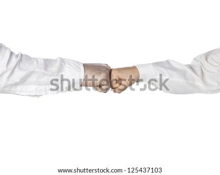 Fist bump gesture of two person against white background #125437103