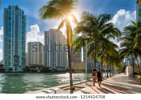Downtown Miami, People Walking along Miami River #1254424708