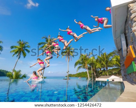 The girl is relaxing in the pool at the sea.Sea in summer.Relaxing on the beach.Slow motion.jumping.Slow motion jumping.  #1254426472