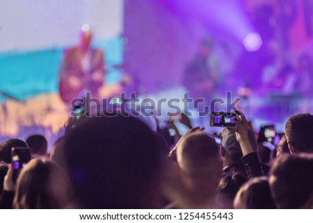 Use advanced mobile recording, fun concerts and beautiful lighting, Candid image of crowd at rock concert, Close up of recording video with smartphone, Enjoy the use of mobile photography #1254455443