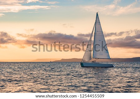 Sailboats on the background of the sunset over the sea #1254455509