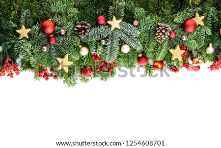 Christmas decorative background border with red bauble decorations, holly berries, spruce and pine cones #1254608701