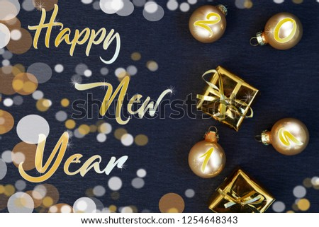 Golden Christmas decoration on black background. Golden Xmas. Flat lay. Merry Christmas and Happy New Year #1254648343