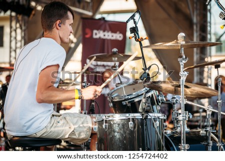 Yessentuki, Stavropol Territory / Russia - August 12, 2017: drumfest drummers festival.musician on stage playing drumsticks on drums Outdoors #1254724402