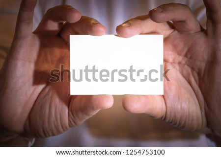 Two hands holding a blank business card. Resource for designers.