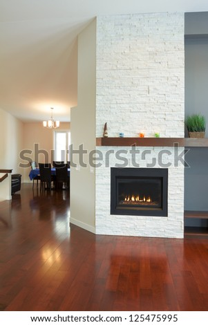 Interior design of modern Living room with fireplace in a new house #125475995