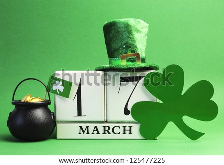 Save the date white block calendar for St Patrick's Day, March 17, with Leprechaun hat and pot of gold, on green background.