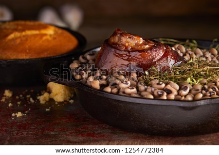 Traditional New years meal black eyed peas and ham hock with cornbread.   #1254772384