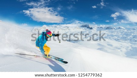 Alpine skier skiing downhill, panoramic format. Winter sports and leasure activities #1254779362