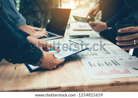 Teamwork with business people analysis cost graph on desk at meeting room. #1254815659