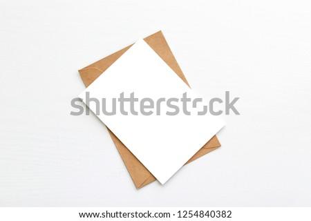 Hello winter. Blank white postcard postcard flyer on a grey background #1254840382