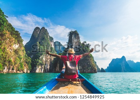Man traveler on boat joy fun with nature rock mountain island scenic landscape Khao Sok National park, Famous travel adventure place Thailand, Tourism beautiful destinations Asia holiday vacation trip #1254849925