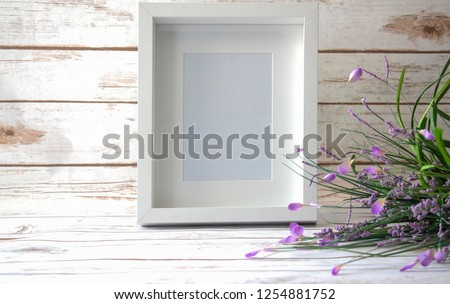 5x7, 8x10 white frame with wild flowers on a white wood background. #1254881752