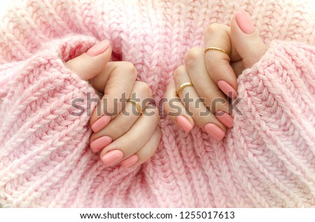 Nail Polish. Art Manicure. Modern style pink Nail Polish.Stylish pastel Color pink Nails holding wool material sleeve blouse . Classic wedding bride nails design #1255017613