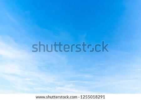 Air clouds in the blue sky. #1255018291