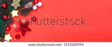 View  of Red christmas holidays decoration on a red background #1255020994