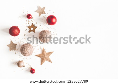 Christmas composition. Christmas red and golden decorations on white background. Flat lay, top view, copy space #1255027789