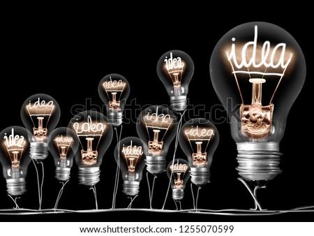 Photo of light bulb group with shining fibers in a shape of Idea word isolated on black background; concept of innovation, teamwork, synergy, collaboration, planning and strategy #1255070599