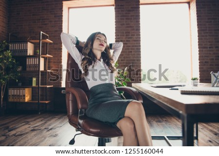 Low below angle view of nice lovely elegant classy attractive adorable charming wavy-haired lady closed eyes sitting in chair at work place station open space #1255160044