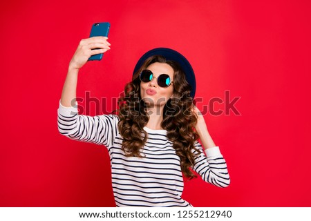Portrait of nice lovely attractive wavy-haired lady wearing striped pullover sunhat taking making romantic selfie isolated over bright vivid shine red background