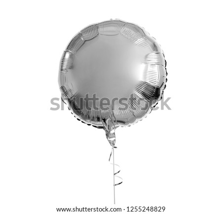 holidays, birthday party and decoration concept - one metallic silver inflated helium balloon over white background #1255248829