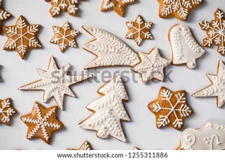 Big set Christmas gingerbread: gingerbread houses, crescent, gingerbread man, snowflakes, sock, Christmas tree, bell, star, new year's ball on white background