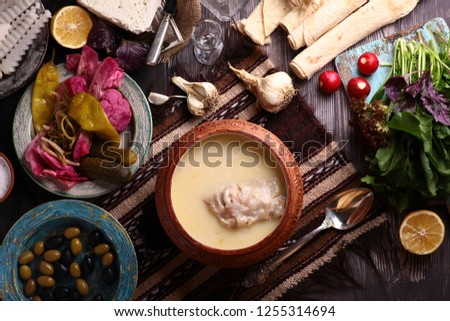 Armenian Xash soup with cow legs meat ,lavash armenian bread ,onion and soil  #1255314694