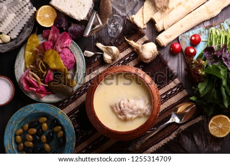 Armenian Xash soup with cow legs meat ,lavash armenian bread ,onion and soil  #1255314709