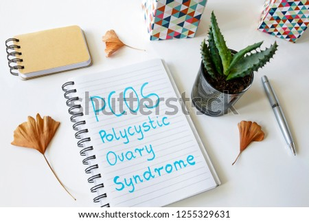 PCOS Polycystic ovary syndrome written in a notebook on white table #1255329631